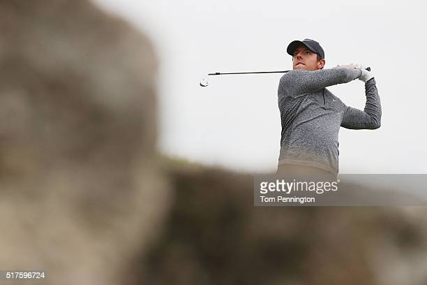 Rory McIlroy of Northern Ireland watches his tee shot on the seventh hole during the round of 16 in the World Golf ChampionshipsDell Match Play at...