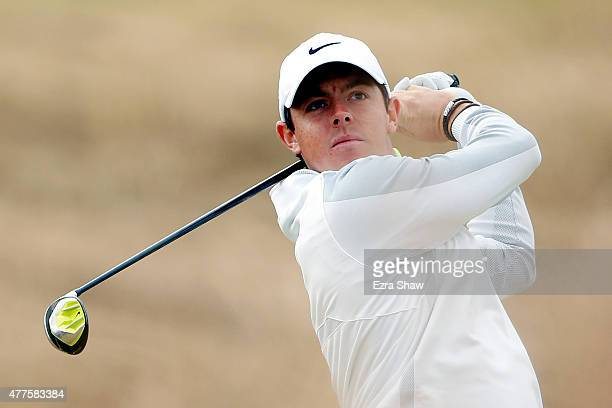 Rory McIlroy of Northern Ireland watches his tee shot on the tenth hole during the first round of the 115th US Open Championship at Chambers Bay on...