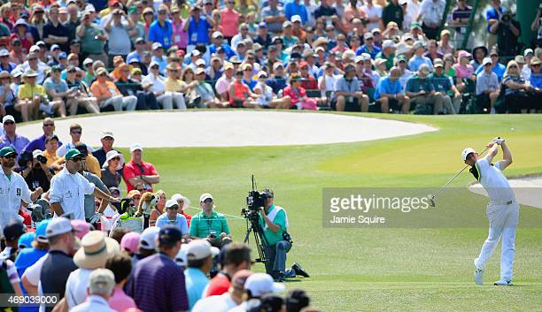 Rory McIlroy of Northern Ireland watches his tee shot on the third hole during the first round of the 2015 Masters Tournament at Augusta National...