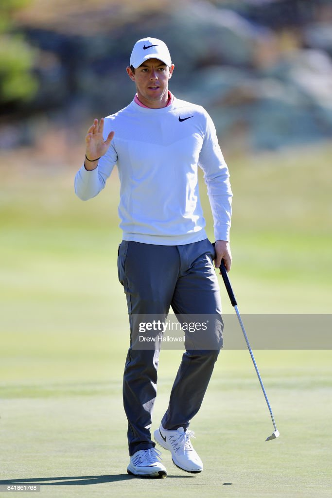 Rory McIlroy of Northern Ireland waves after putting for birdie on the 12th green during round two of the Dell Technologies Championship at TPC Boston on September 2, 2017 in Norton, Massachusetts.