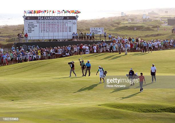 Rory McIlroy of Northern Ireland waves his hat as he walks up the 18th fairway during the Final Round of the 94th PGA Championship at the Ocean...