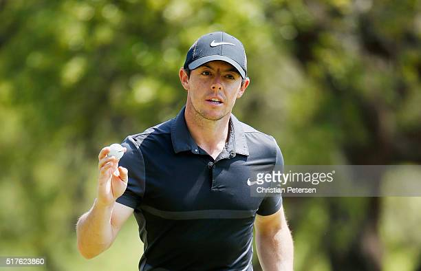 Rory McIlroy of Northern Ireland waves to the gallery on the sixth green during the round of 8 in the World Golf ChampionshipsDell Match Play at the...