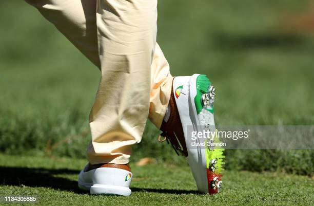 Rory McIlroy of Northern Ireland wearing a special commemorative pair of Nike golf shoes in memory of the late Arnold Palmer during the first round...