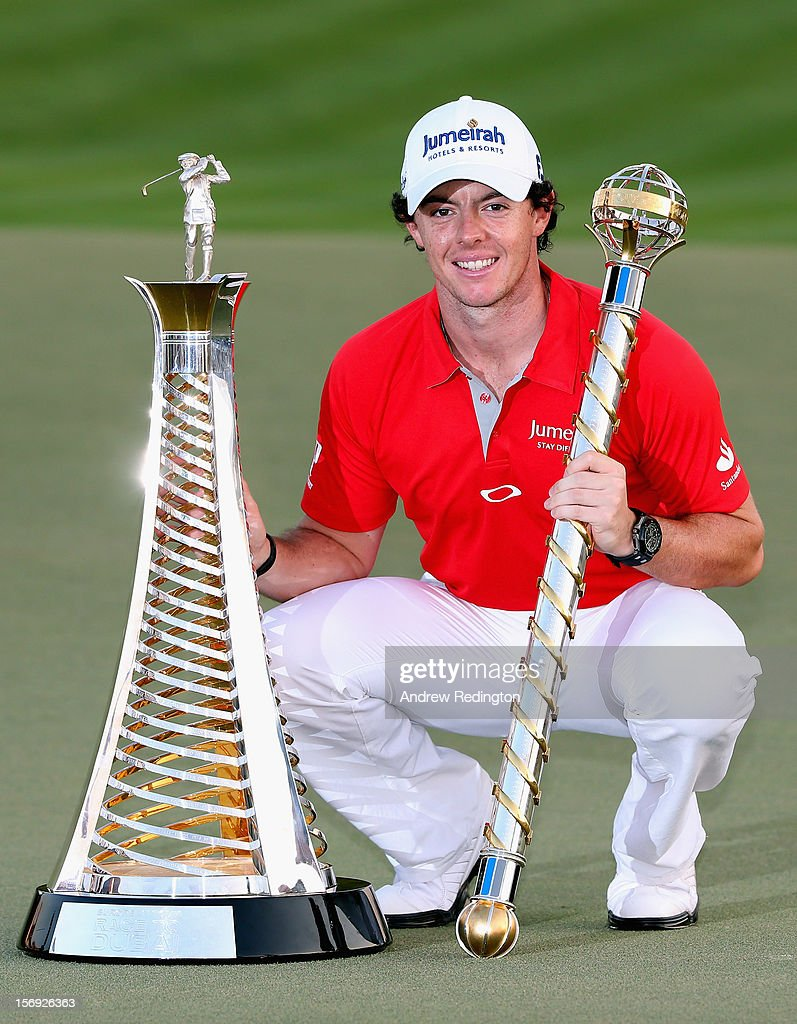 Rory McIlroy of Northern Ireland with both the Race To Dubai and DP World Tour Championship trophies after winning the DP World Tour Championship on the Earth Course at Jumeirah Golf Estates on November 25, 2012 in Dubai, United Arab Emirates.