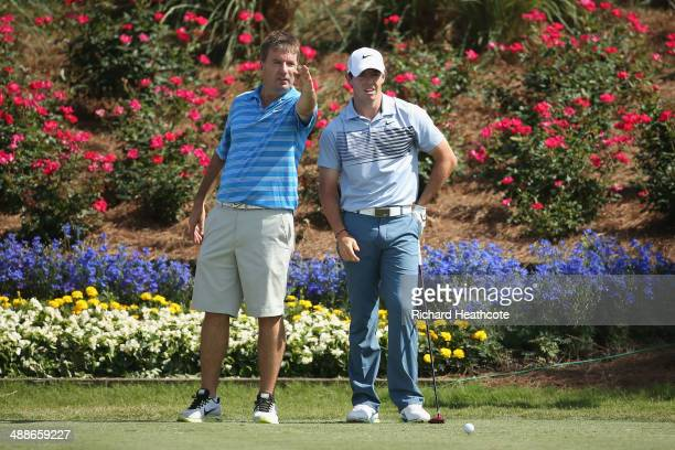 Rory McIlroy of Northern Ireland with caddy JP Fitzgerald during a practice round ahead of THE PLAYERS Championship on The Stadium Course at TPC...