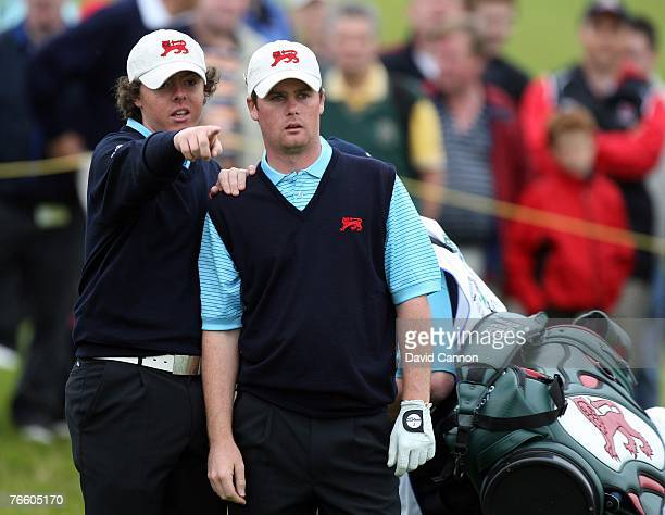 Rory McIlroy of Northern Ireland with his partner Jonathan Caldwell of Ireland at the 1st hole during the morning foursomes matches in the 2007...