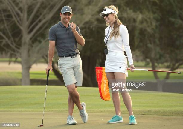 Rory McIlroy of Northern Ireland with Paige Spiranac of The United States during the proam as a preview for the Omega Dubai Desert Classic on the...
