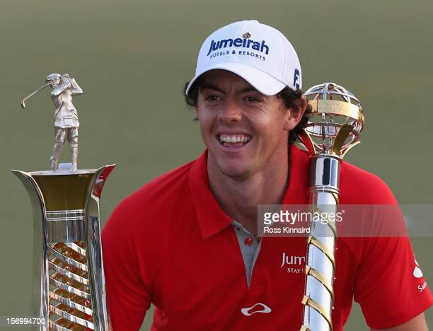 Rory McIlroy of Northern Ireland with the DP World Tour Championship and The Race to Dubai trophy on the 18th green during the final roung of the DP...