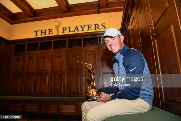 Rory McIlroy of Northern Ireland with THE PLAYERS Championship trophy in the Champions locker room after the final round of THE PLAYERS Championship...