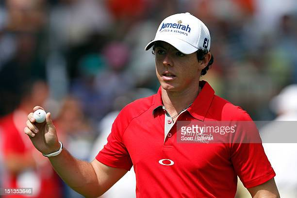 Rory McIlroy of Northern Irelandreacts after he made a birdie putt on the 10th hole green during the first round of the BMW Championship at Crooked...
