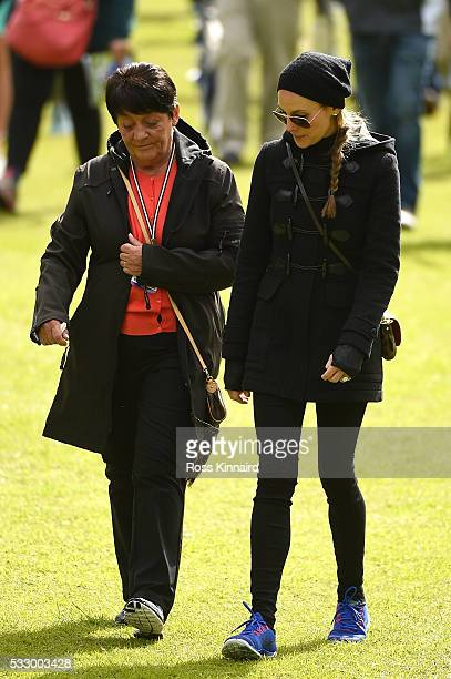 Rory McIlroy of Northern Ireland's mother Rose and Fiancee Erica Stoll follow his group during the second round of the Dubai Duty Free Irish Open...