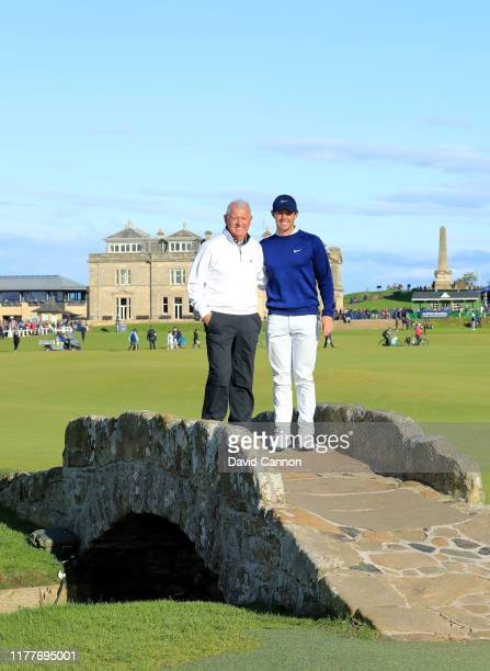Rory McIlroy of Northern Irteland poses with his father Gerry McIlroy on the 18th hole during the third round of the Alfred Dunhill Links...