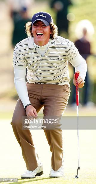 Rory McIlroy of Northern reacts after watching playing partner horse racing training Mike De Kock attempt a shot from the seaweed on the 15th hole...