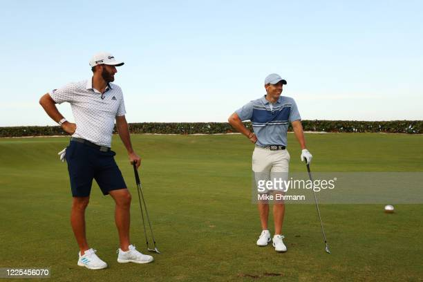 Rory McIlroy of the American Nurses Foundation team and Dustin Johnson of the American Nurses Foundation team react on the 17th tee after winning the...
