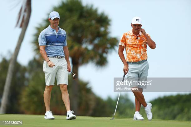 Rory McIlroy of the American Nurses Foundation team and Rickie Fowler of the CDC Foundation team look on from the fourth green during the TaylorMade...