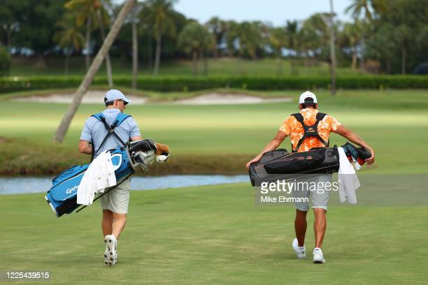 Rory McIlroy of the American Nurses Foundation team and Rickie Fowler of the CDC Foundation team walk on the ninth hole during the TaylorMade Driving...