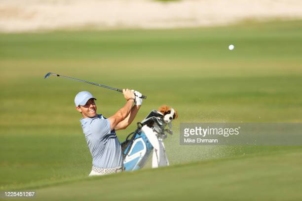 Rory McIlroy of the American Nurses Foundation team plays a shot from a bunker on the 15th hole during the TaylorMade Driving Relief Supported By...