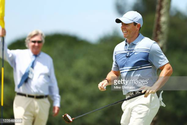 Rory McIlroy of the American Nurses Foundation team reacts as Mark Russell, Vice President, Rules & Competition for the PGA Tour, holds the pin flag...
