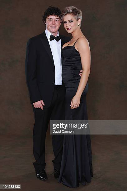 Rory McIlroy of the European Ryder Cup team poses with his partner Holly Sweeney prior to the 2010 Ryder Cup Dinner at the Celtic Manor Resort on...