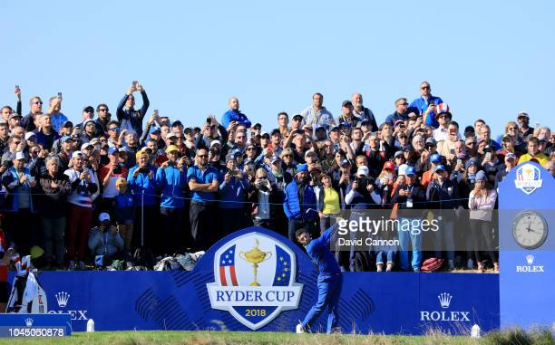 Rory McIlroy of the European Team hits his tee shot on tyhe second hole in his match against Justin Thomas of the United States Team during singles...