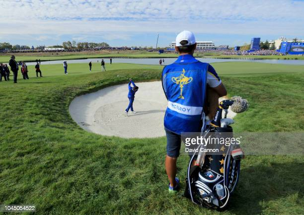 Rory McIlroy of the European Team hits his third shot on the 18th hole in his match against Justin Thomas of the United States Team during singles...