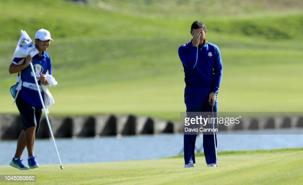 Rory McIlroy of the European Team misses a birdie putt on the 15th hole in his match against Justin Thomas of the United States Team during singles...