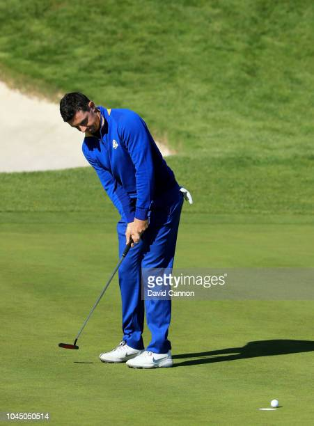 Rory McIlroy of the European Team misses a birdie putt on the first hole in his match against Justin Thomas of the United States Team during singles...