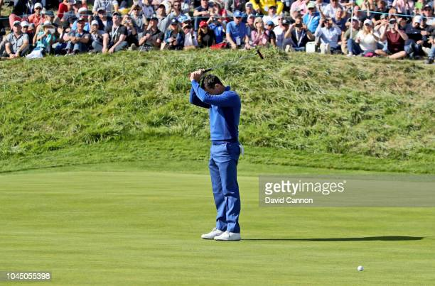 Rory McIlroy of the European Team misses a birdie putt on the ninth hole in his match against Justin Thomas of the United States Team during singles...
