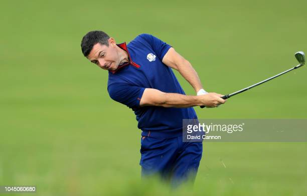 Rory McIlroy of The European Team plays his second shot on the 10th hole during the morning fourball matches of the 2018 Ryder Cup at Le Golf...