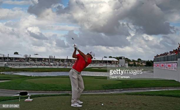 Rory McIlroy of the Northern Ireland plays his tee shot on the par 3 17th hole during the first round of the 2018 Honda Classic on The Champions...