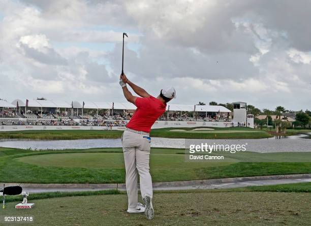 Rory McIlroy of the Northern Ireland plays his tee shot on the par 3 17th hole with a long iron during the first round of the 2018 Honda Classic on...