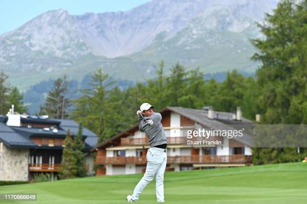 Rory McIlroy plays a shot during the Pro Am prior to the start of the Omega European Masters at CranssurSierre Golf Club on August 28 2019 in...