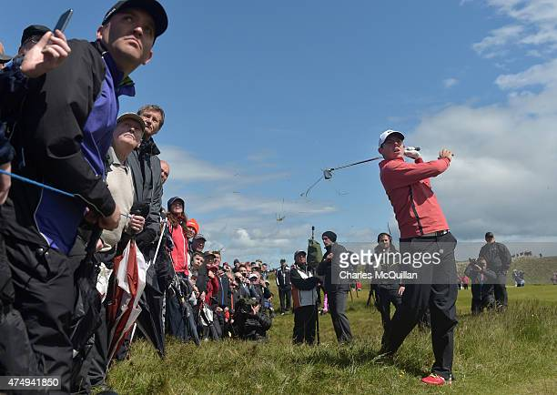 Rory McIlroy plays from the rough on the 8th hole during Day One of the Irish Open at Royal County Down Golf Club on May 28 2015 in Newcastle...