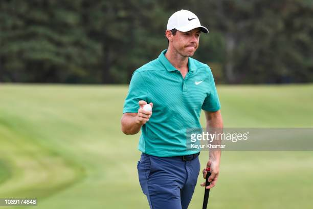 Rory McIlroy waves his ball to fans on the 17th hole green during the final round of the TOUR Championship the final event of the FedExCup Playoffs...
