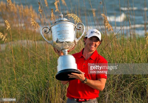 Rory McIlroy with the trophy after winning the 94th PGA Championship on August 12 2012 on Kiawah Island South Carolina AFP PHOTO/DON EMMERT