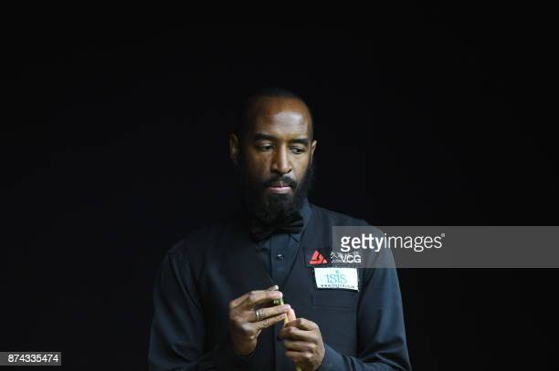 Rory McLeod of England chalks the cue during the first round match against Stephen Maguire of Scotland on day two of 2017 Shanghai Masters at...