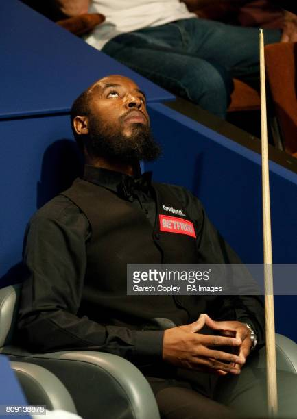 Rory McLeod waits in his chair in his second round match against John Higgins during the Betfredcom World Snooker Championships at the Crucible...