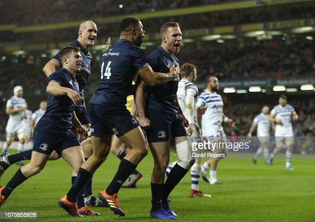 Rory O'Loughlin of Leinster celebrates with team mates after scoring their second try during the Champions Cup match between Leinster Rugby and Bath...