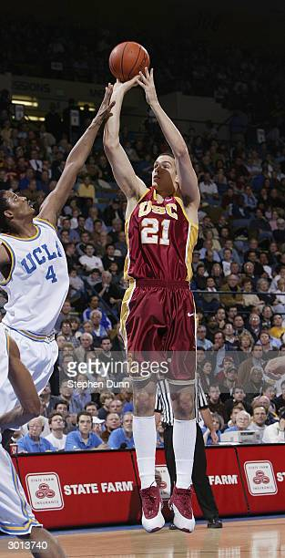 Rory O'Neil of the USC Trojans shoots a jumper over Trevor Ariza of the UCLA Bruins during the game on January 28 2004 at Pauley Pavillion in...
