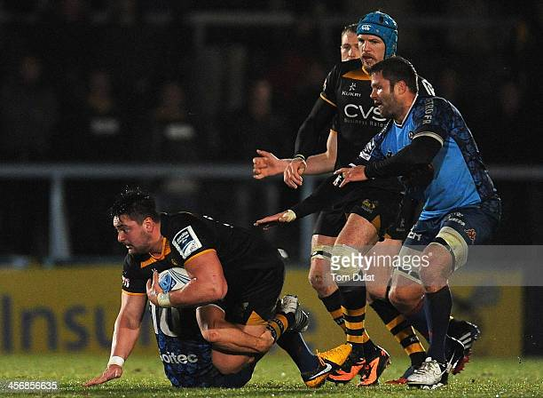 Rory Pitman of London Wasps is tackled by Ollie Barkley of Grenoble during the Amlin Challenge Cup match between London Wasps and Grenoble at Adams...