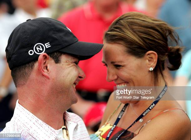 Rory Sabbatini and his wife Amy celebrate his playoff victory on the 18th green after the final round of the Crowne Plaza Invitational at Colonial in...