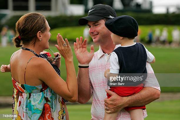 Rory Sabbatini gets a highfive from his wife Amy while holding son Harley after winning the Crowne Plaza Invitational at Colonial on May 27 2006 in...