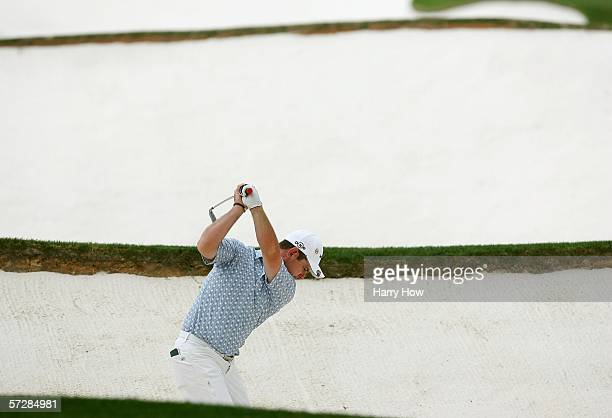 Rory Sabbatini hits from the bunker on the 18th hole during the second round of The Masters at the Augusta National Golf Club on April 7 2006 in...