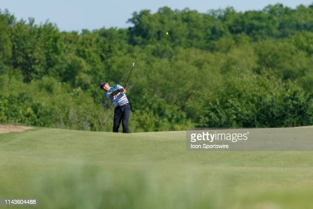 Rory Sabbatini hits his approach shot to the 15th green during the final round of the ATT Byron Nelson on May 12 2019 at Trinity Forest Golf Club in...