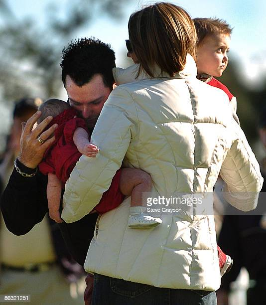Rory Sabbatini kisses his daughter Tylie Jo as he is joined by wife Amy and son Harley on the 18th green after winning the 2006 Nissan Open Presented...