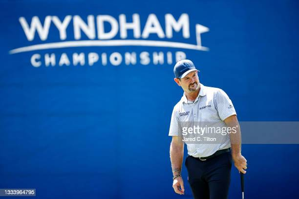 Rory Sabbatini of Slovakia looks on from the 18th green during the second round of the Wyndham Championship at Sedgefield Country Club on August 13,...