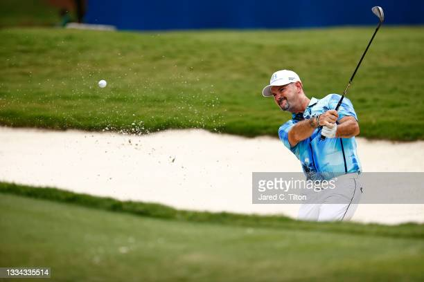 Rory Sabbatini of Slovakia plays a shot from a bunker on the 18th hole during the final round of the Wyndham Championship at Sedgefield Country Club...