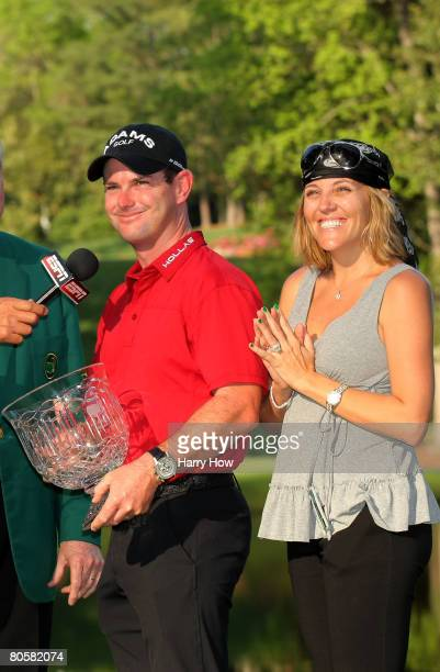 Rory Sabbatini of South Africa and his wife Amy pose with the trophy after winning the Par 3 Contest prior to the start of the 2008 Masters...