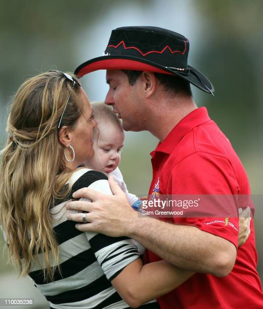 Rory Sabbatini of South Africa hugs his wife Amy and son Bodhi after winning The Honda Classic at PGA National Resort and Spa on March 6 2011 in Palm...