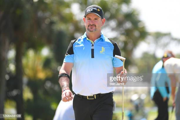 Rory Sabbatini of South Africa walks on the practice green during the final round of The Honda Classic at PGA National Champion course on March 1...